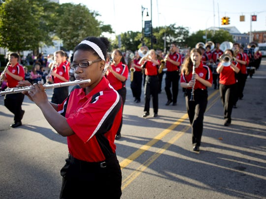 Members of the Port Huron Marching Band perform during the Rotary International Day Parade July 15, 2015, in Port Huron.