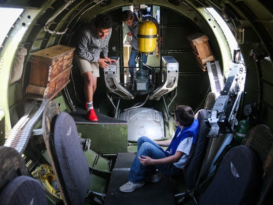 Jaidden Villanueva and Peyton Harris check out the seats in the cargo bay of a B-17 Flying Fortress during the Wings of Freedom tour Tuesday, April 3, 2018, at San Angelo Regional Airport.