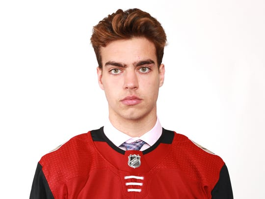 Kevin Bahl poses after being selected 55th overall by the Arizona Coyotes during the 2018 NHL Draft at American Airlines Center on June 23, 2018 in Dallas, Texas.