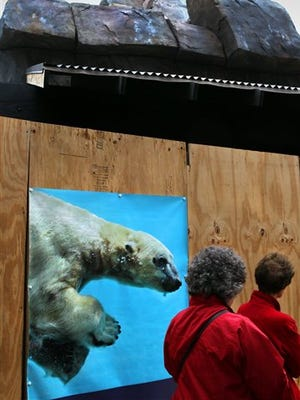 St. Louis Zoo visitors pass the McDonnell Polar Bear Point after leaving the penguin exhibit on Monday, April 13, 2015 in St. Louis.  The Buffalo Zoo has applied to move its bear to the new facility, scheduled to open June 6. (Robert Cohen/St. Louis Post-Dispatch via AP)  EDWARDSVILLE INTELLIGENCER OUT; THE ALTON TELEGRAPH OUT; MANDATORY CREDIT