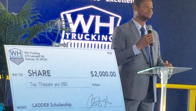 Carlo White. president/CEO of WH Trucking announced plans to help empower families to get out of poverty, partly with an annual gift to SHARE.
