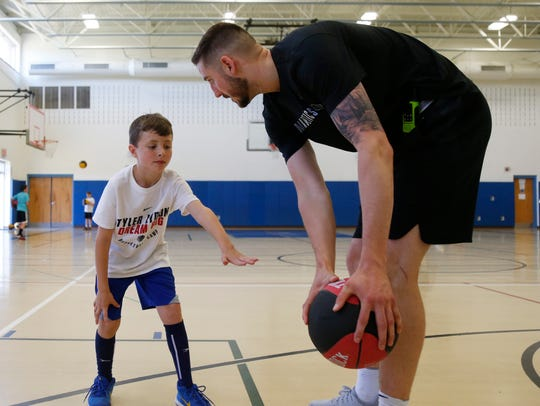 Patrick Fenn attempts to get the ball away from Tyler Lydon during the inaugural Tyler Lydon Dream Big Basketball Camp at Stissing Mountain High School on Tuesday.