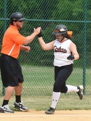 Marlboro High School's Lily Moresco celebrates her three-run home run in the first inning with head coach, Ryan Naccarato, during Saturday's New York state Class B regional championship versus Center Moriches at Rhinebeck High School.