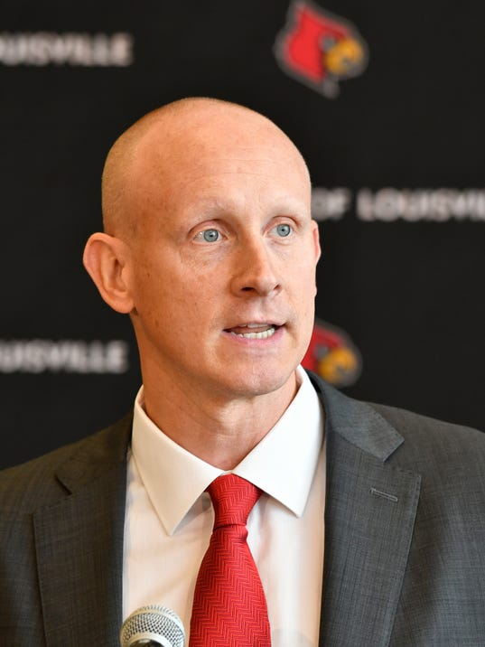 Chris Mack addresses the media after he was introduced as Louisville's new head basketball coach during an NCAA college basketball press conference, Wednesday, March 28, 2018, in Louisville, Ky. (AP Photo/Timothy D. Easley)