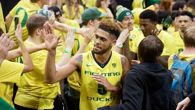 Jan 6, 2016; Eugene, OR, USA; Oregon Ducks guard Tyler Dorsey (5) celebrates with fans after a game against the California Golden Bears at Matthew Knight Arena. The Ducks won 68-65. Mandatory Credit: Troy Wayrynen-USA TODAY Sports