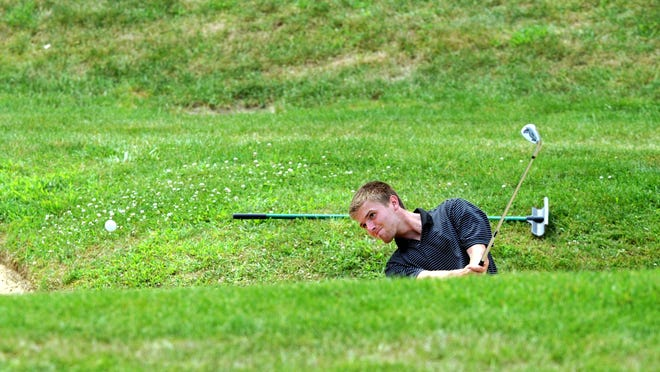 Zack Forker hits from a bunker on the 18th hole during the second round of the Zanesville District Golf Association Amateur tournament on Sunday at EagleSticks.