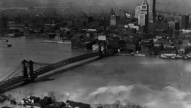 1937: This aerial photograph taken above the Kentucky shore in 1937 shows the flood waters lapping at the Suspension Bridge, which was the only  non flooded link from Pittsburgh to Cairo, Ill.