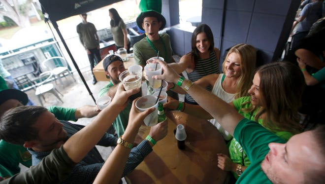 Patrons celebrate St. Patrick's Day at Finnegan's Wake in the Midtown last year.