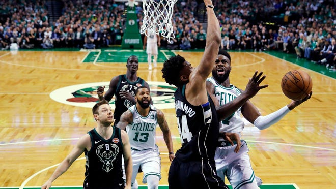 Boston Celtics guard Jaylen Brown, right, drives to the basket against Milwaukee Bucks forward Giannis Antetokounmpo (34) during the first quarter of Game 5 of an NBA basketball first-round playoff series in Boston, Tuesday, April 24, 2018.