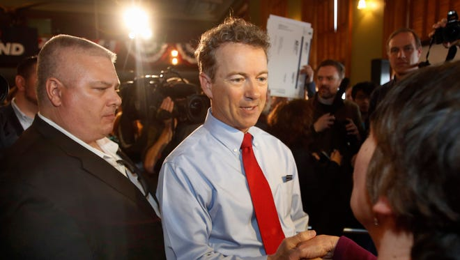 Republican Presidential candidate, Sen. Rand Paul, R-Ky., greets supporters, Wednesday, April 8, 2015, in Milford, N.H. Paul, a newly declared Republican presidential candidate, is dodging a central question about abortion: What exceptions, if any, should be made if the procedure were to be banned? In an interview with The Associated Press on Wednesday, Paul would not say where, in his view, a pregnant woman's rights begin and those of the fetus end.(AP Photo/Jim Cole)