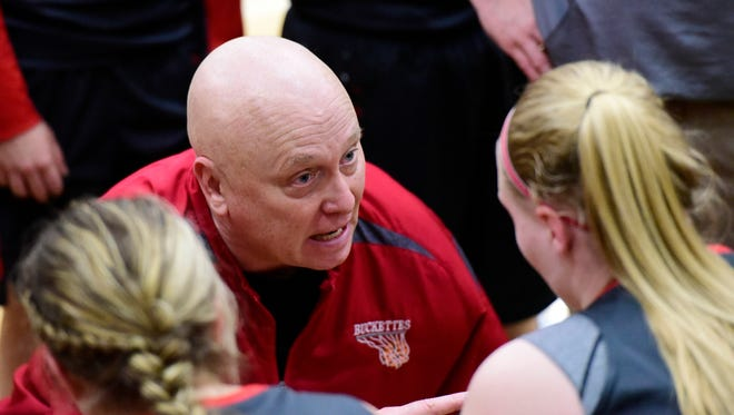 Greg Moore coaches his team in the regional semifinal last year.