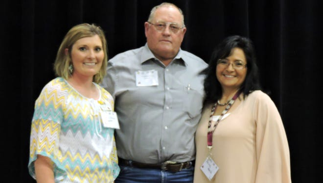 Preston Stone receives the New Mexico CowBelles' (NMCB) 2016 Man of the Year award from Ashley Ivins (left), of Corriente CowBelles; and Anita Hand, NMCB President.