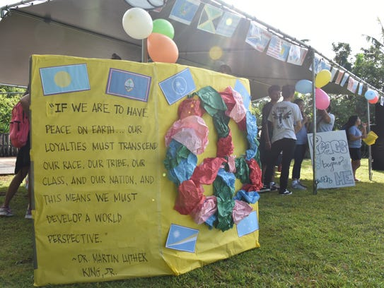 A poster displays a message about peace, at the VSA