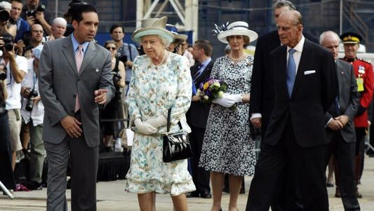 Glenn Guzi, left, program director for the Port Authority of New York and New Jersey, guides Queen Elizabeth II and Prince Philip on a tour of the World Trade Center site in 2010.