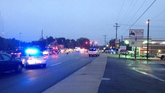 Police on the scene of a fatal hit and run on White Horse Road.
