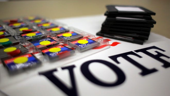 In this Thursday, March 9, 2017 photo, a stack of zip disks and a tray of compact flash cards are seen at the Bexar County Elections office, in San Antonio. Bexar County's voting equipment is among the oldest in America's second-largest state and will have to be replaced soon. Election officials in states across the U.S. are eager to replace aging fleets of voting machines but are grappling with how to fund the nation's next generation of voting equipment. (AP Photo/Eric Gay)