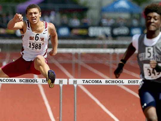 South Kitsap's Deyondre Davis (center) clears the final hurdle during the Class 4A boys 300-meter hurdles race Saturday at the state track and field championships at Mount Tahoma High School.