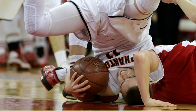 West De Pere High School's #11 Jake bostedt ends up on his head after battling for a loose ball against Mount Horeb High School during their Division 2 semifinal basketball game in the 100th annual WIAA State Boys Basketball Tournament at the Kohl Center on March 20, 2015, in Madison, Wis.Wm.Glasheen/Post-Crescent Media