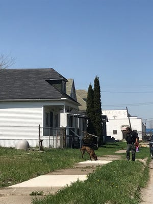 Police are at the scene where a 3-year-old child was shot in Detroit on Tuesday, May 8, 2018.