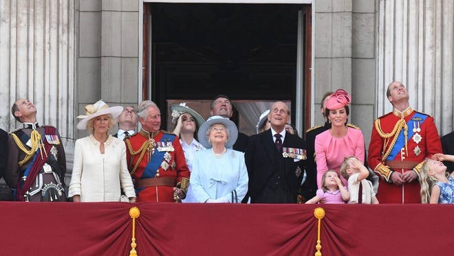 It's just not a royal event without a balcony shot. From left: Prince Edward, Camilla, Duchess of Cornwall, Prince Andrew, Prince Charles, Princess Beatrice of York, The Queen, Elizabeth II, Commander Tim Laurence,  Philip, The Duke of Edinburgh, Catherine with Charlotte and George, Prince William take in the Royal Air Force flyover.