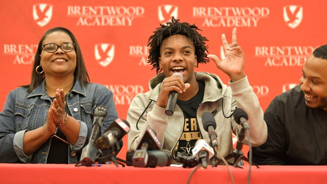 Basketball star Darius Garland, with mom, Felicia, left, and brother, Desmond Nunnery, and father, Winston Garland, not pictured, announces his college decision at a press conference Monday at Brentwood Academy.