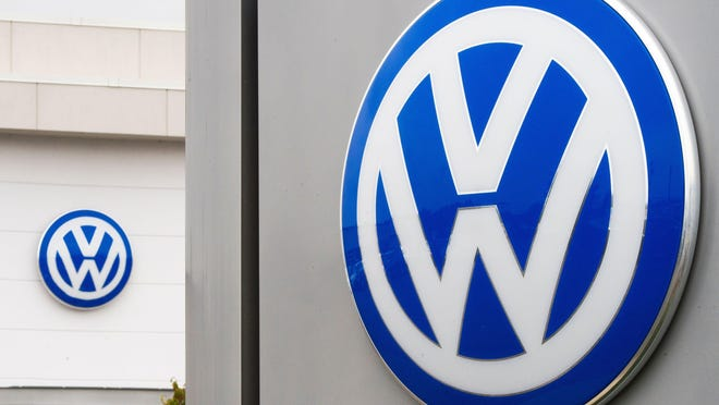 The German automaker and the self-driving startup based in Silicon Valley and Pittsburgh will work together to develop a driverless, ride-sharing vehicle fleet in cities, Volkswagen said in a statement Thursday.