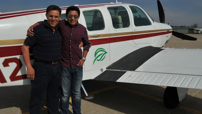 Babar and Haris Suleman, of Plainfield, are shown on April 27, 2014, in Greenwood, Ind., as they prepared to  fly around the world in their single-engine aircraft. Their dream came to a tragic end in July, when the plane crashed off Pago Pago in American Samoa.
