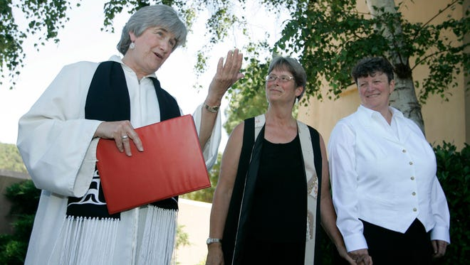 In this June 20, 2008 photo, the Reverend Dr. Jane Spahr, left, a Presbyterian minister, performs a same-sex marriage for Sherrie Holmes, center, and Sara Taylor, at the Marin Civic Center in San Rafael, Calif.