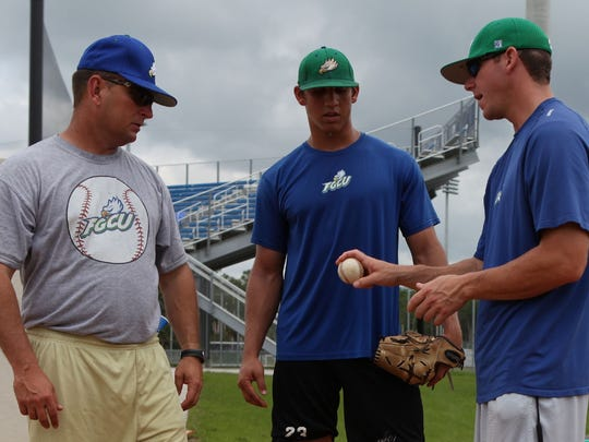 FGCU coach Dave Tollett, left, and then FGCU pitching coach Forrest Martin, right, work with pitcher Jacob Barnes, who became the program's fourth major leaguer after being called up Wednesday, June 1, by the Milwaukee Brewers.