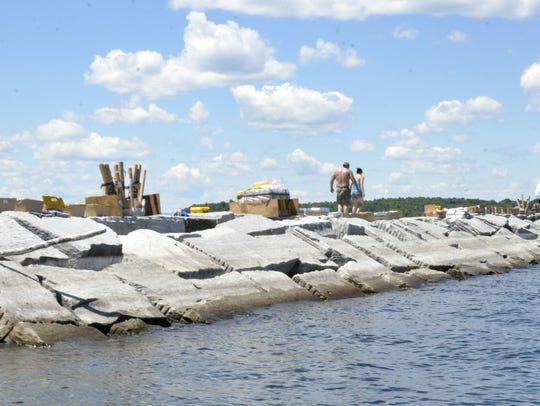 Workers set up fireworks on the breakwater of Burlington's