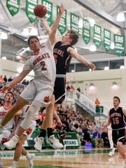 Central York's Braden Richard shoots against Northeastern's
