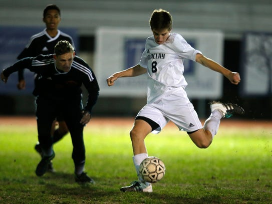 Maclay's Daniel Sweeney attempts a shot on goal against