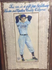 A poster which accompanied a car that the City of Wausau presented Johnny Schmitz with after his retirement from a 15-year major league baseball career