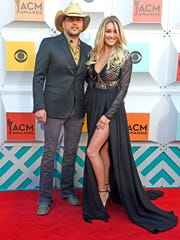 Jason Aldean and wife Brittany Kerr on the red carpet at the 51st Academy of Country Music Awards at Las Vegas' MGM Grand Garden Arena on April 3, 2016