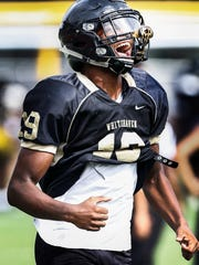 Whitehaven defensive back Rayshad Williams pumps himself