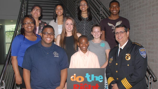 Bottom row, left to right: James Weathers III, Di-Juan Anderson, Police chief Michael Ciminelli; Middle row: Amari Boone, Selin Kahyaoglu, Brooke Simmons; Top row: Aleah McCall, Hilleryi Binet, Aidee Zorilla, Jehmel Alexander
