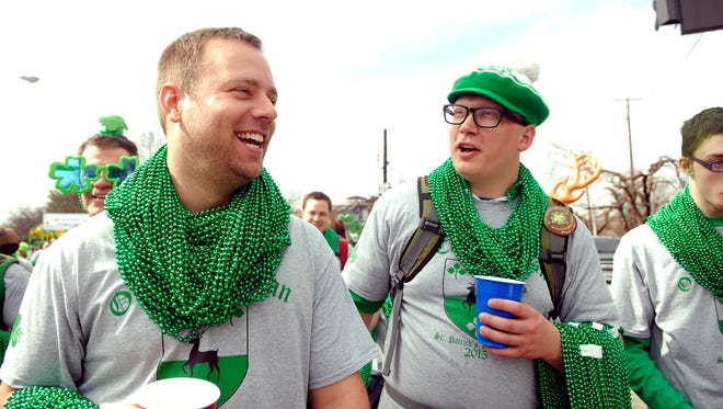 Wes Felts, left, and Craig O'Connell, right, march in the St. Patrick's Day Parade.  March 14, 2015