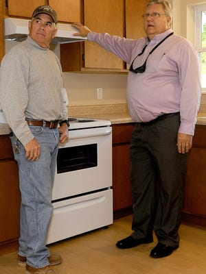 Tim Sheahan, left, project manager of E.M. Harris Construction Co., St. Louis; and Phil Steinhaus, CEO of the Columbia Housing Authority; survey 2016 renovations in a remodeled unit at Stuart Parker Apartments. Steinhaus on Friday announced he would retired at the end of March.