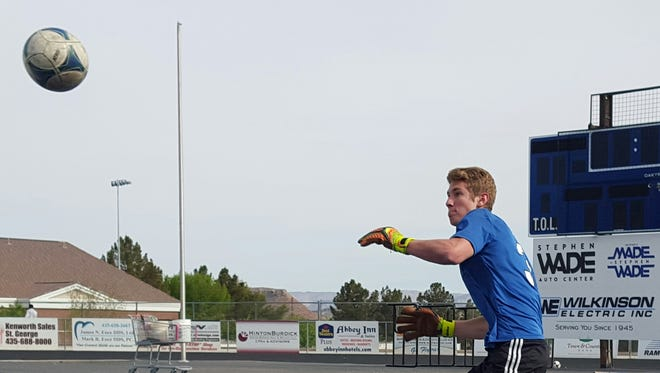 Dixie soccer senior goalkeeper Ethan Poulton goes through a training exercise during practice April 6, 2016.