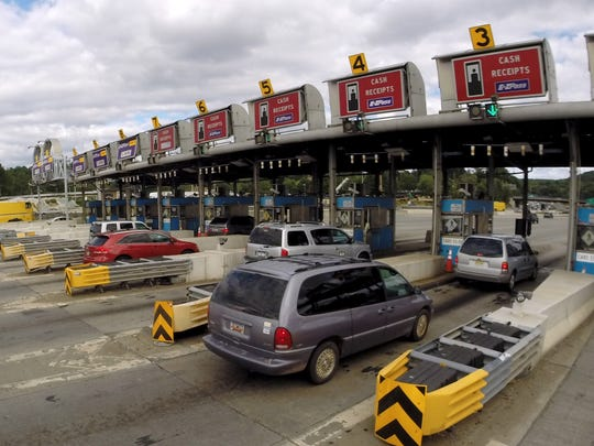 Cars pull into the toll booths in Tarrytown after crossing the Tappan Zee Bridge.