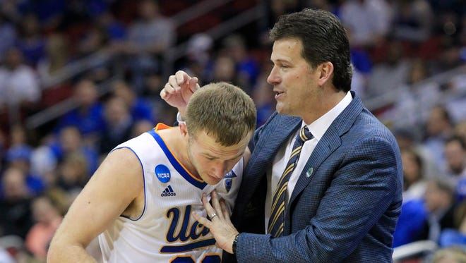 UCLA guard Bryce Alford is congratulated by his father, head coach Steve Alford, as he leaves the floor at the end of the second half of an NCAA tournament third round college basketball game in Louisville, Ky., Saturday, March 21, 2015. UCLA won the game 92-75.
