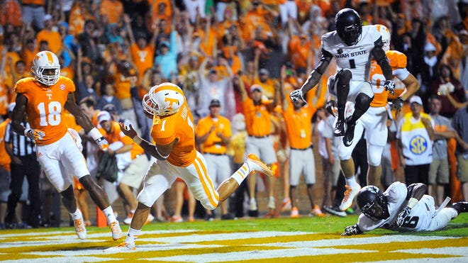 Tennessee running back Jalen Hurd (1) runs in for a touchdown against Utah State at Neyland Stadium.