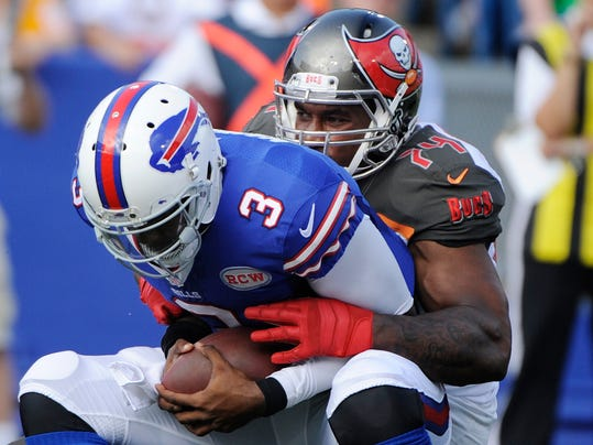 Tampa Bay Buccaneers' Larry English, right, sacks Buffalo Bills quarterback EJ Manuel (3) during the first half of a preseason NFL football game Saturday, Aug. 23, 2014, in Orchard Park, N.Y. (AP Photo/Gary Wiepert)