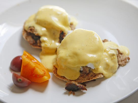 The eggs benedict during brunch at HOQ Sunday, Aug.