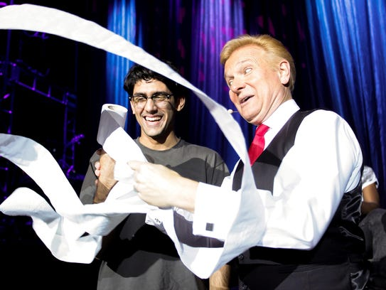 "Magician Jeff Hobson, right, earns his nickname ""The"
