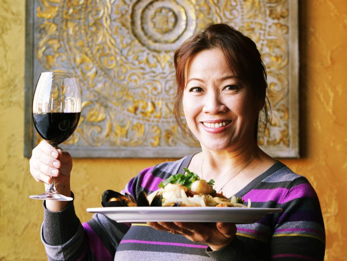 Wednesday January 29th, 2014, Bangkok Restaurant and Jazz Bar 225 E. Ohio St., owner Pooky Rary holds her family recipe for Ginger Lovers' Pad Khing, a sea food stir-fry with shredded ginger, carrots, mushrooms and bell peppers.