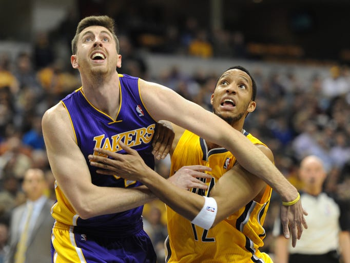 Indiana's Evan Turner fights for rebound position with Los Angeles' Ryan Kelly  in the second quarter  as the Indiana Pacers hosted the Los Angeles Lakers at Bankers Life Fieldhouse Tuesday February 25, 2014.