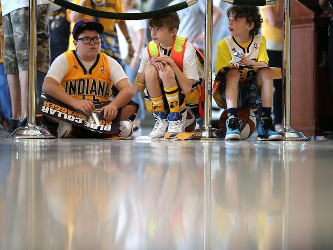 Pacers fane Dan Dougherty,left, Nico DeNatles and Dominick DeNatles,right, wait to get into the Pacers game. Indiana Pacers play the Miami Heat in Game #5 of the NBA Eastern Conference Finals Wednesday, May 28, 2014, evening at Bankers Life Fieldhouse.