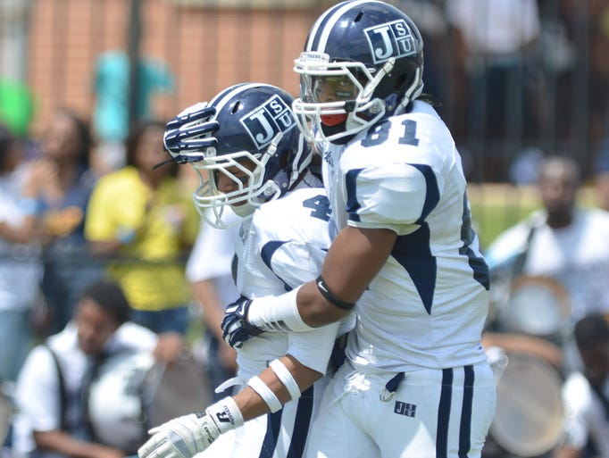 Jackson State white team receiver Jairus Moll, left, celebrates his touchdown with fellow receiver, Daniel Williams, during Saturday's spring football game on the JSU practice field. Williams scored the Tigers first touchdown.