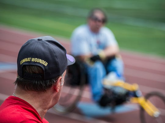 Dennis Haines and Chris Fidler take a break from training as they prepare for the upcoming 37th annual National Veterans Wheelchair Games in Cincinnati, OH on Thursday, July 13, 2017.